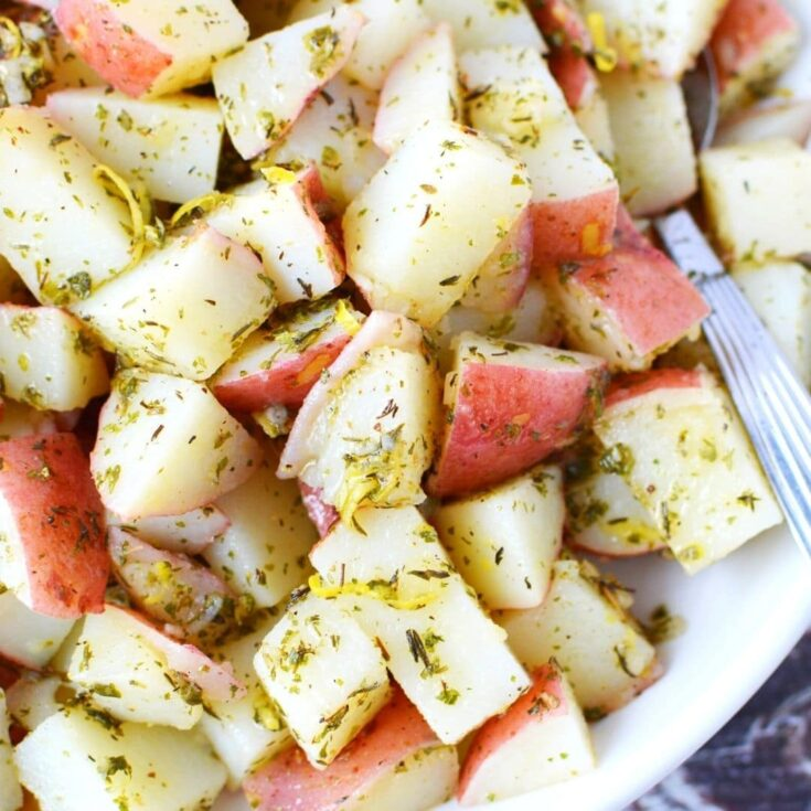 close up of cut potatoes and herbs