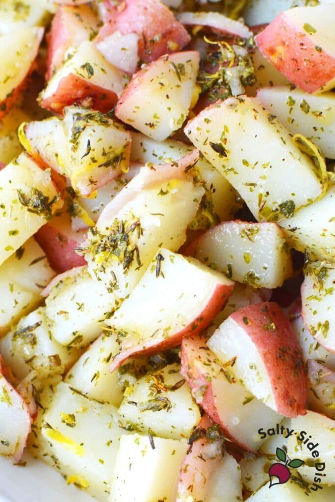 close up of red potatoes and herbs