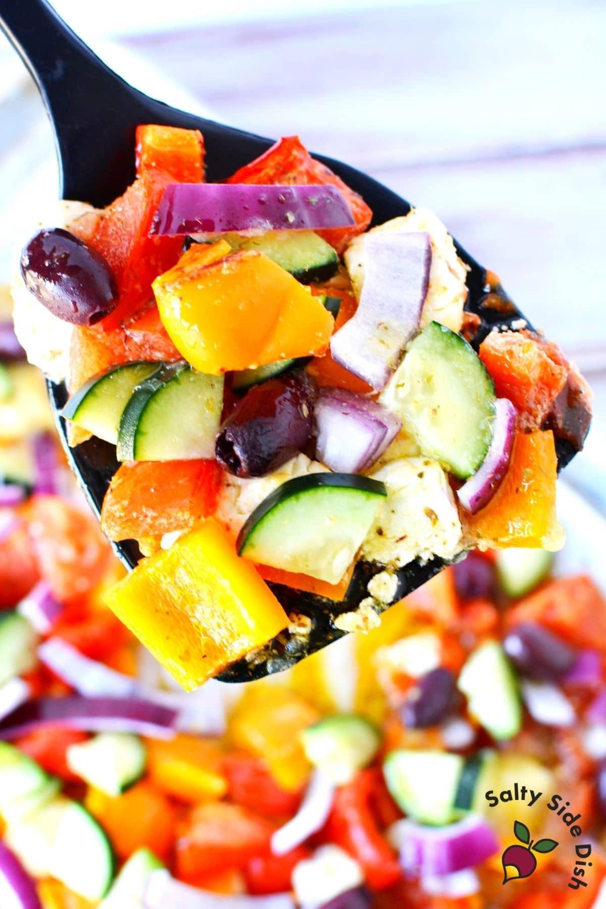 baked greek salad on a spatula