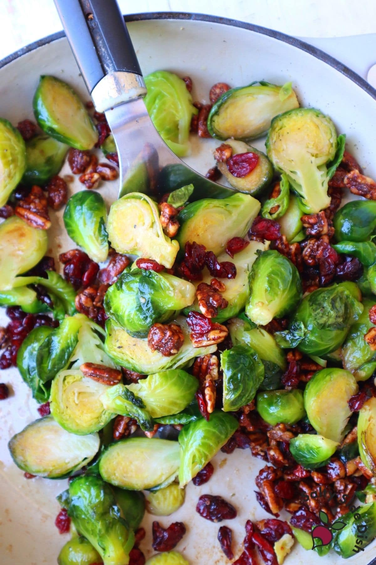 brussels sprouts being served with a spatula