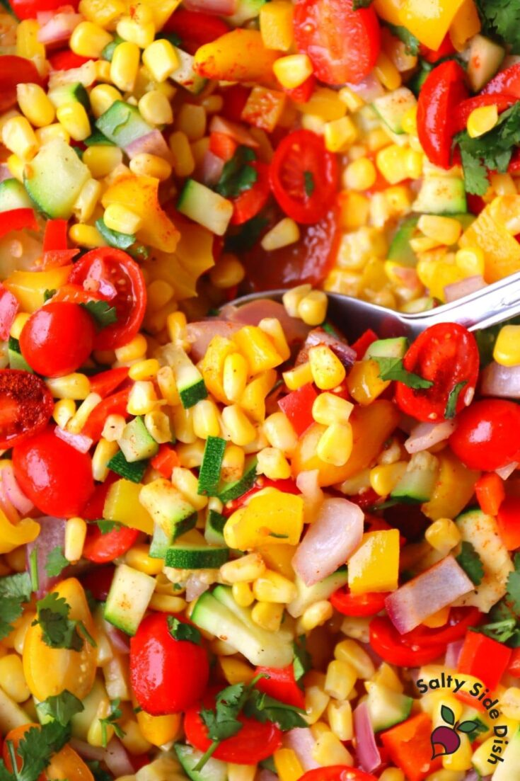 scoop of corn succotash in pot