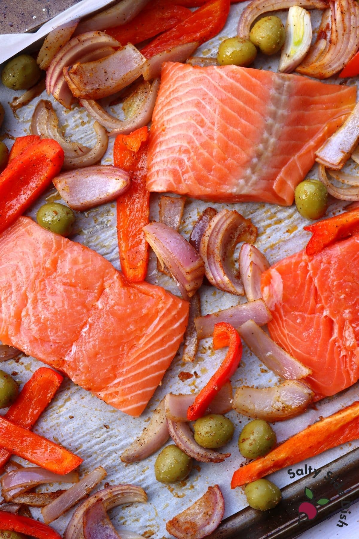 salmon fillets on sheet pan with vegetables