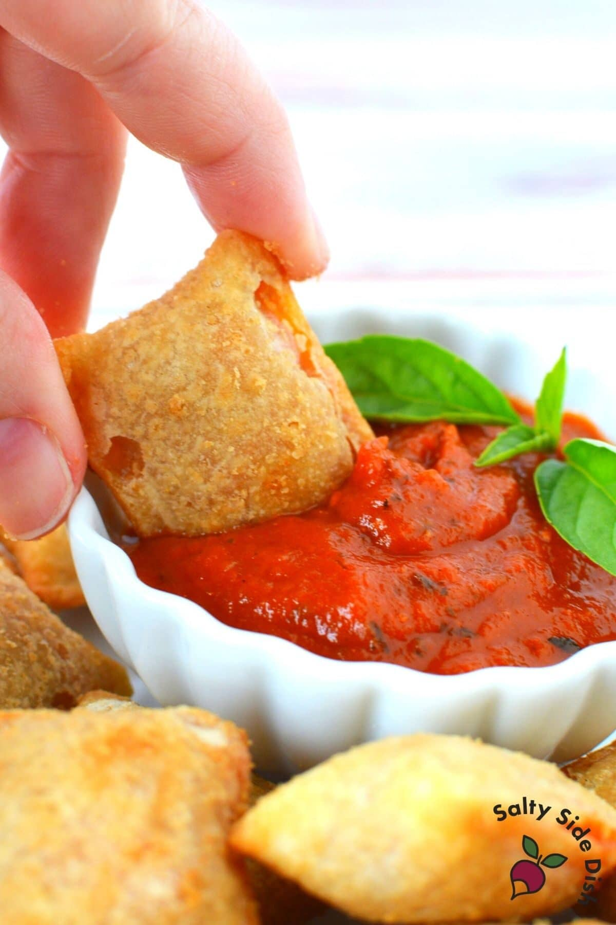 pizza roll in a dipping sauce