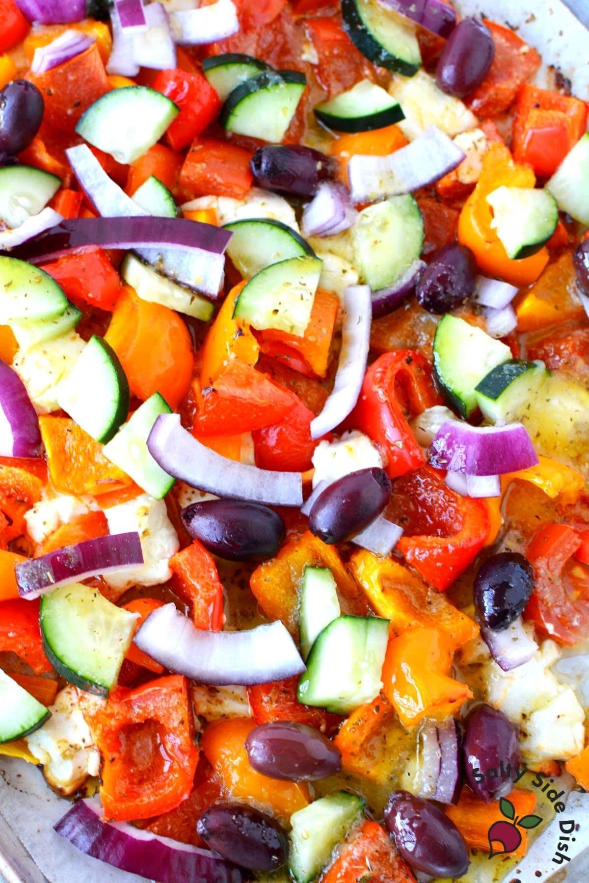 roasted Greek salad on a sheet pan