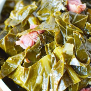 slow cooked collard greens in a bowl with ham