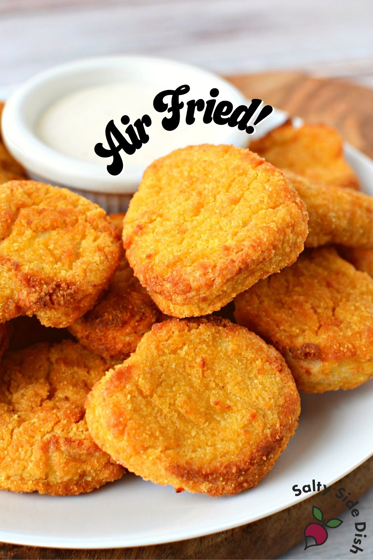 pile of frozen chicken nuggets fresh from air fryer.