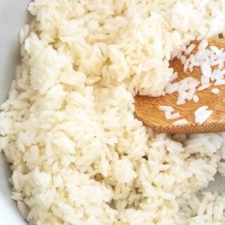 rice in a ninja foodi inner pot and wooden spoon