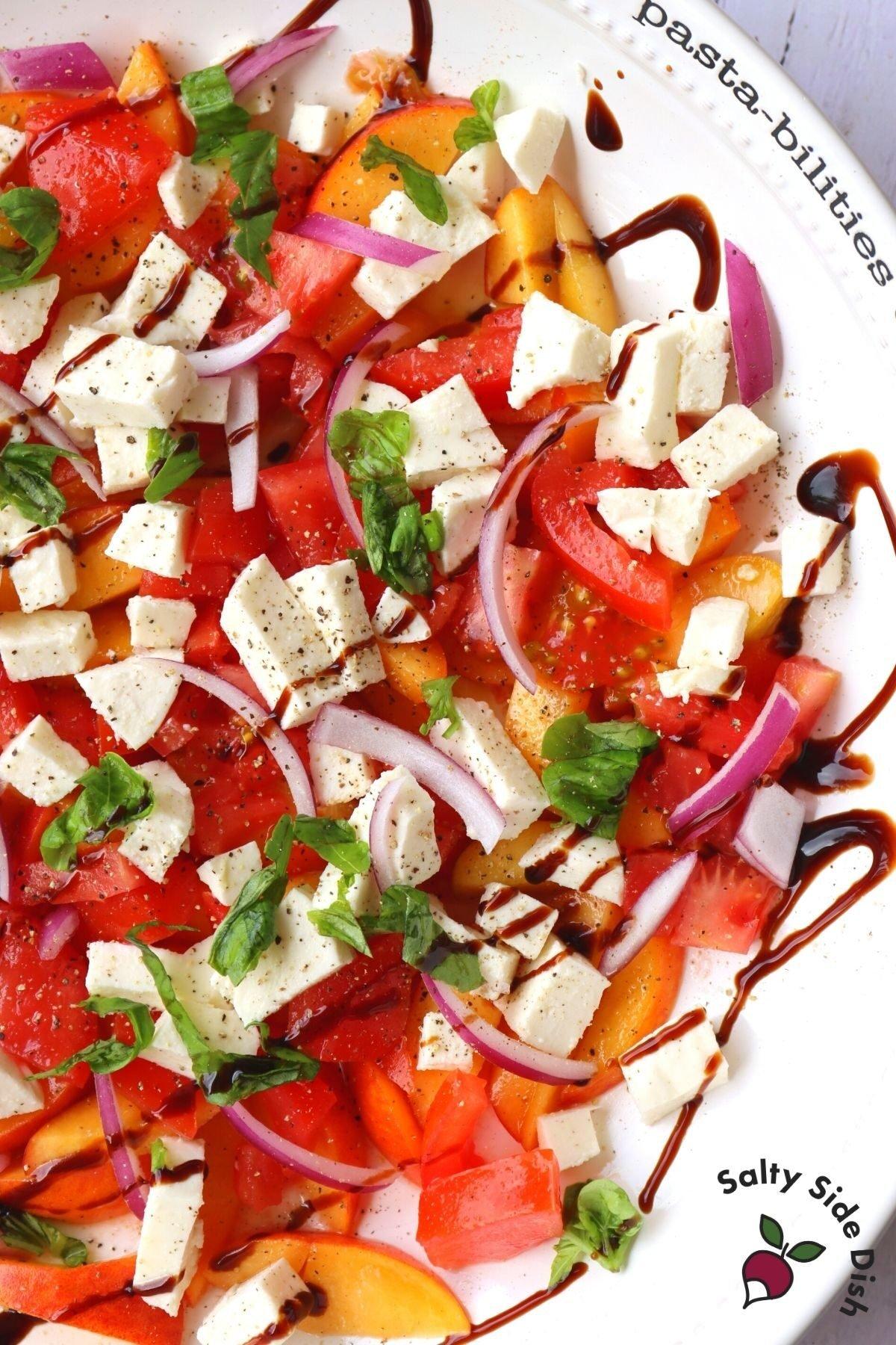peach caprese salad in a bowl