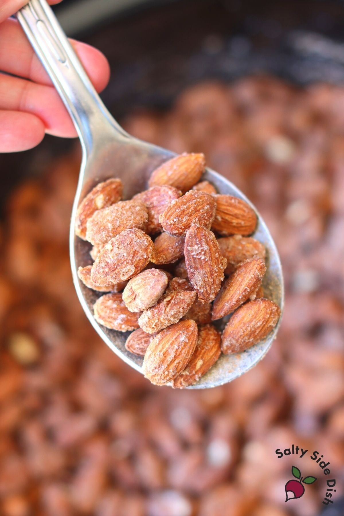 roasted almonds on a spoon