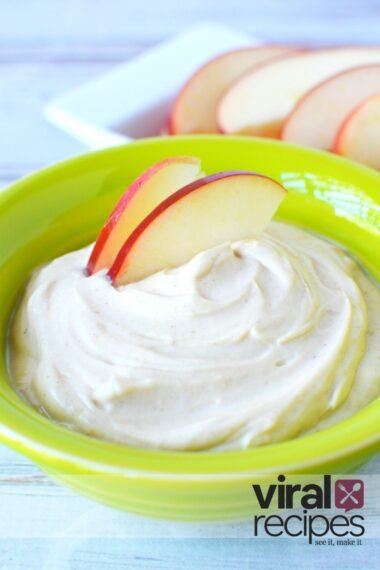 apples dipped into peanut butter dip