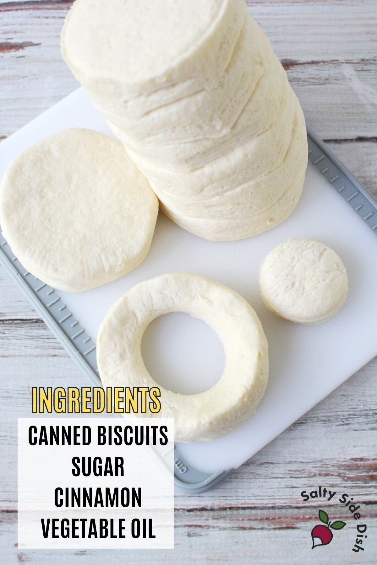 biscuits sitting on a cutting board with ingredient list on bottom left