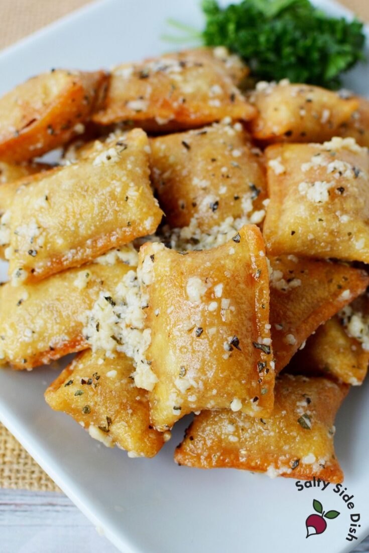 pile of pizza rolls on a plate