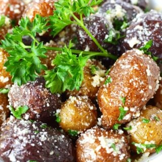 mini potatoes on a white plate with parsley