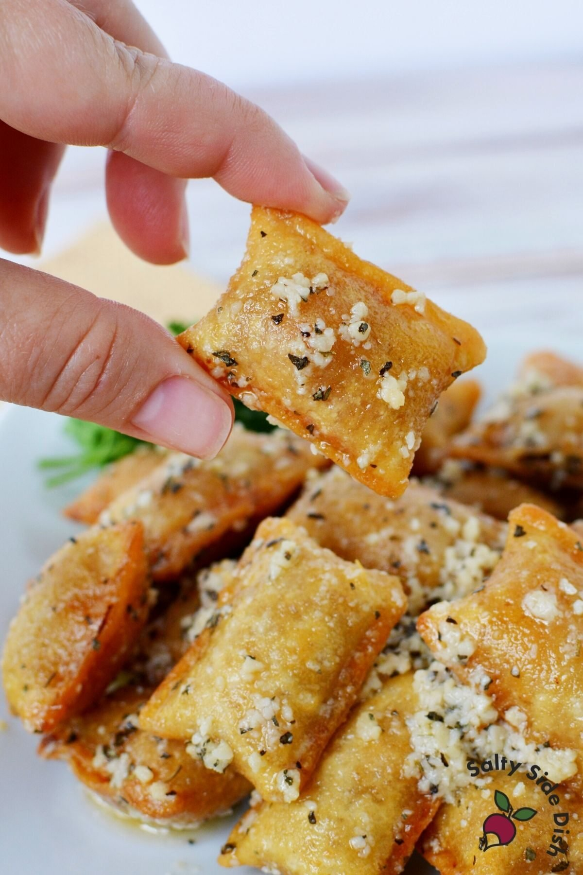 tiktok pizza rolls being held by a hand