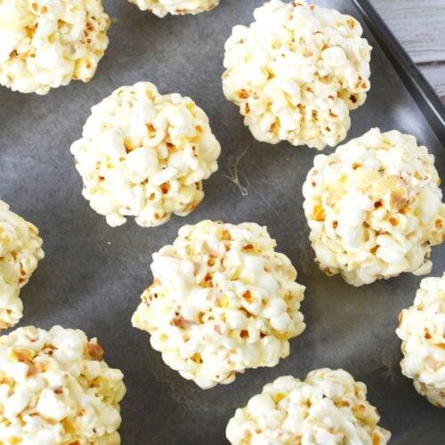 sheet pan full of popcorn balls.