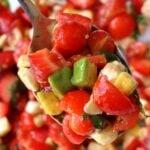 strawberry caprese salad on a spoon.