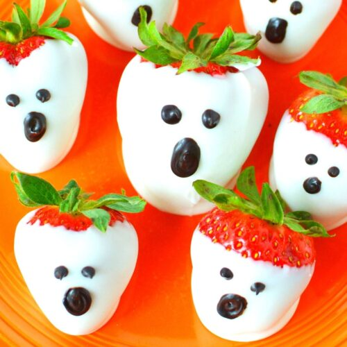 featured strawberry ghosts on a plate.