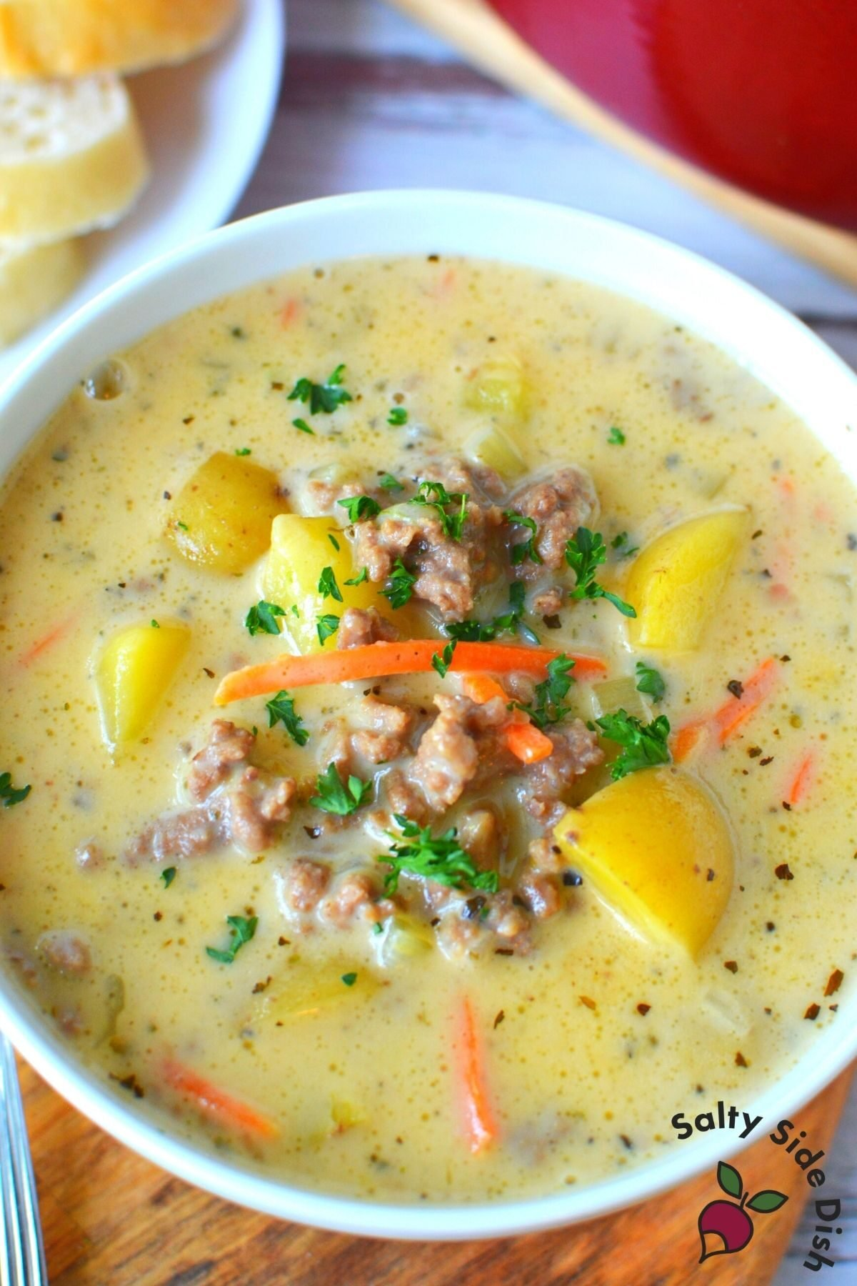 large white bowl of cheeseburger soup ready to serve.