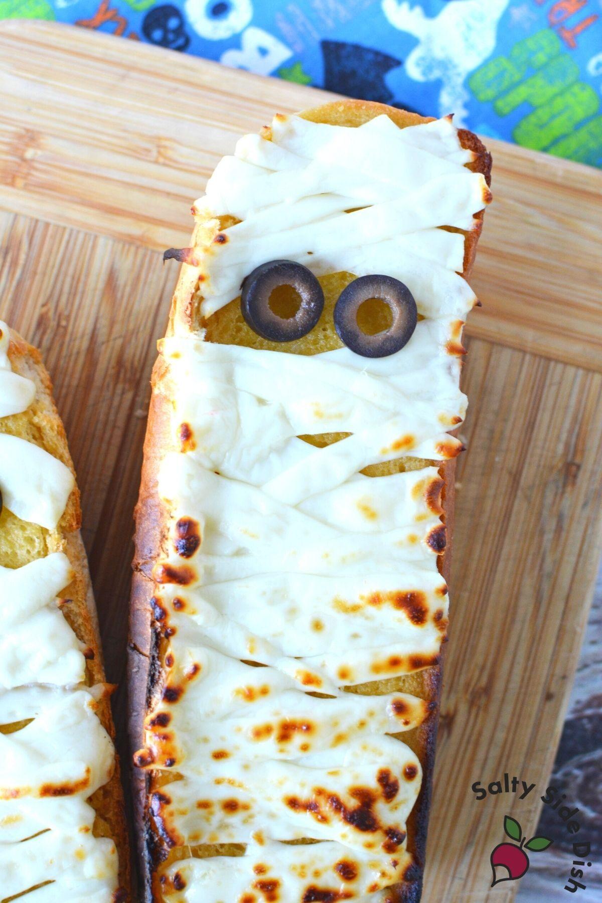 easy halloween garlic bread on a cutting board.