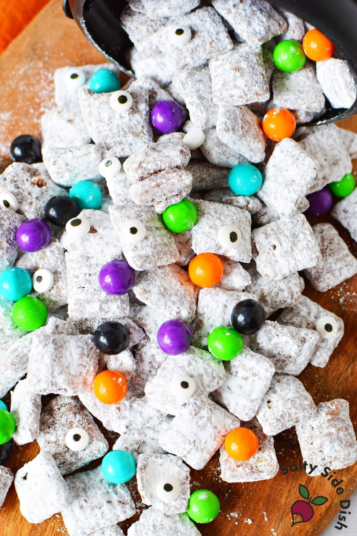 easy halloween muddy buddies laying on a table.