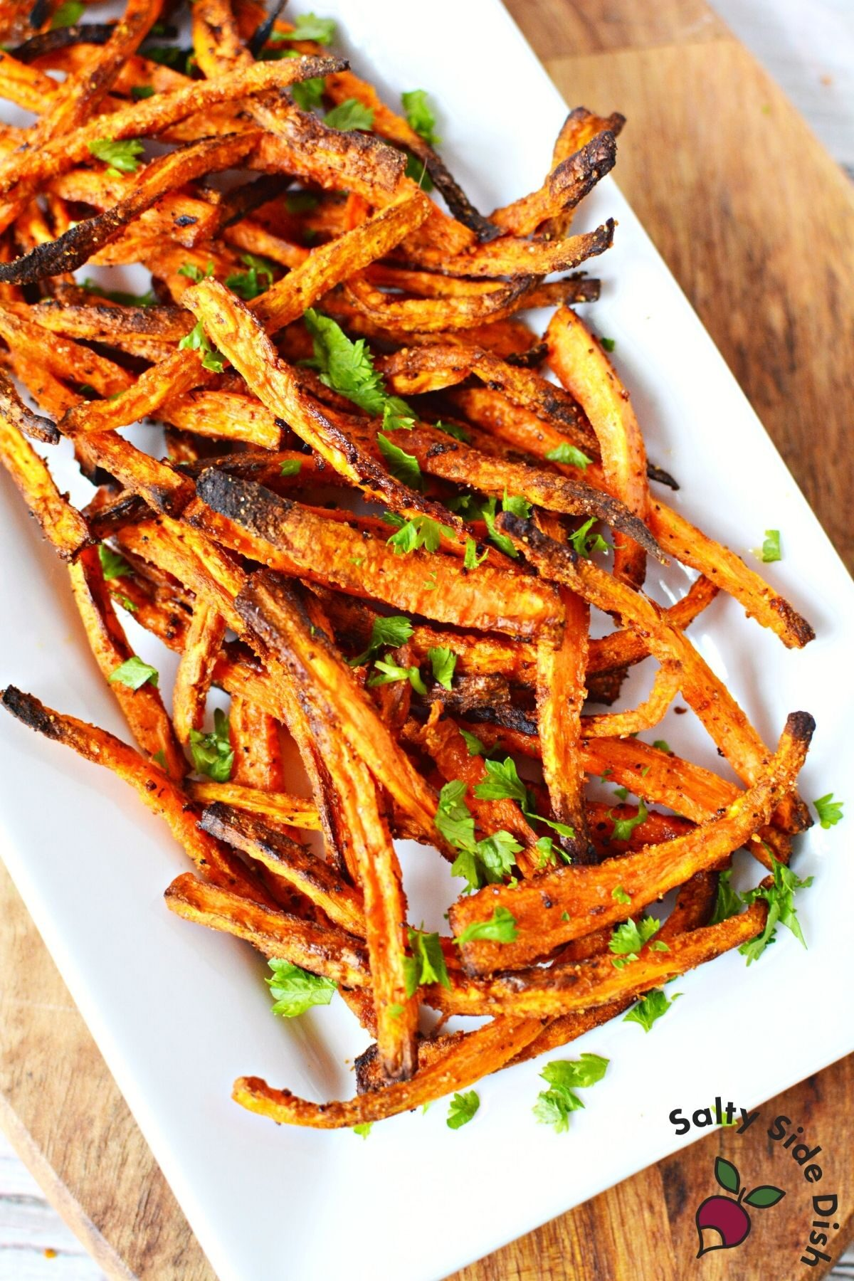 carrot fries on a white plate.